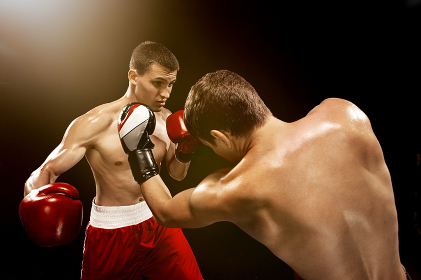 Two professional boxer boxing on black background