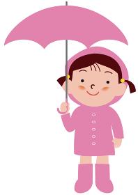 傘をさすレインコートの女の子