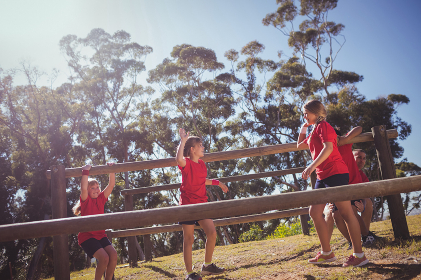 Kids interacting with each other during obstacle course training