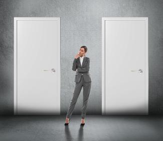 Concept of businesswoman choosing the right door