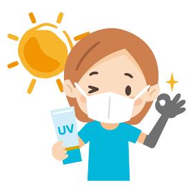 マスクをして日焼け対策をした若い女性