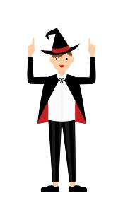 ハロウィンの仮装、魔法使い姿の男の子が両手で指さしをするポーズ