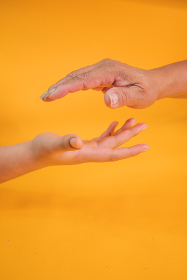 Concept of mother and daughter hands outstretched to get in touch. And share great experiences and learning together.