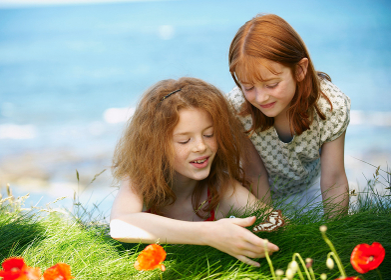 2 girls watching butterfly