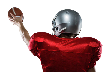Rear view of American football player in red jersey holding ball