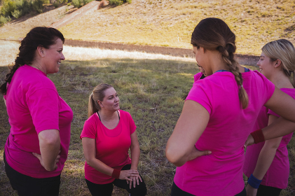 Group of women interacting with each other in the boot camp
