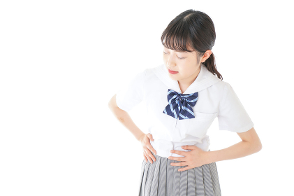 生理痛に苦しむ制服を着た女子学生