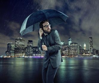 Afraid businessman in the heavy rain