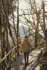 Woman walking in autumn park
