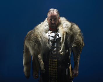 Studio portrait of gladiator wearing wolf fur
