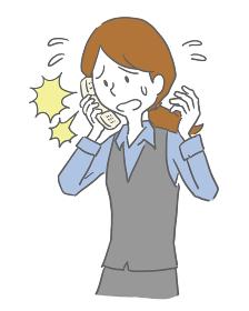 電話対応で焦る女性