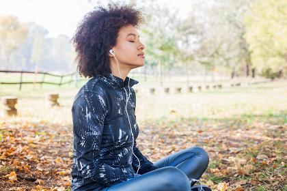 Sporty Afro Woman Enjoy Listening Music After Running