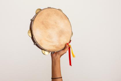 Hand holding tambourine