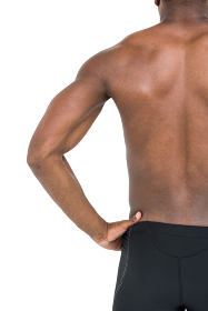 Mid-section of swimmer on white background