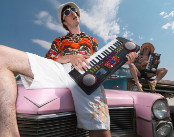 Musicians performing atop abandoned cars