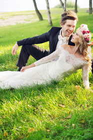 Laughing groom with his lovely young wife