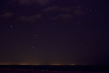 Distant lights from Sicily over the horizon