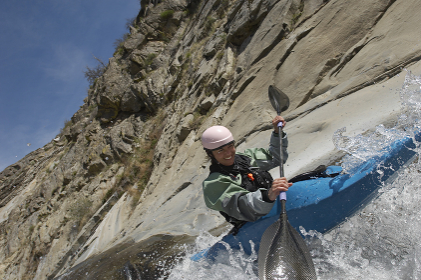 Woman Kayaking On Mountain River