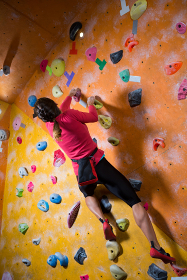 Determined woman practicing rock climbing