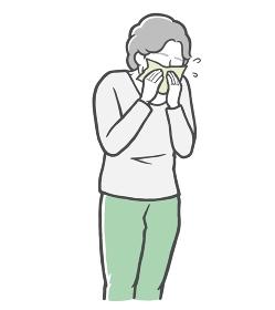 長袖を着て鼻をかむ中年女性