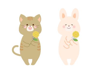 父の日の黄色いバラを持つ猫とうさぎ