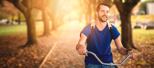 Composite image of young man riding bicycle