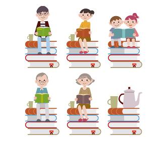 積み上げた本に座って読書をする家族
