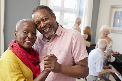 Portrait Of Senior Couple Enjoying Dancing Club Together