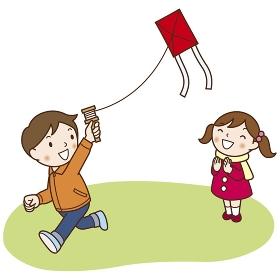 凧揚げをする男の子