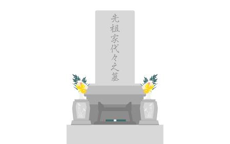 花が飾られ線香が焚かれた先祖代々の墓
