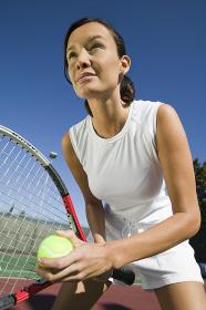 Female Tennis Player Preparing to Serve close up