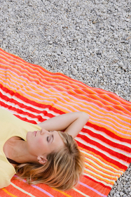 A girl relaxing on a beach towel