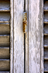 brown wood venetian blind and the rusty in colonia del sacramento uruguay