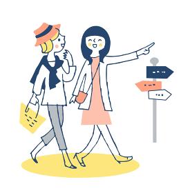 並んで街を歩く若い女性2人