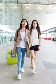 Friends go for a trip and walking to the airport