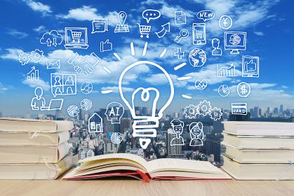 読書で学習する様々な知識・町並みと青空背景-スマホ・パソコン・ネットワーク・ビジネスのアイデア