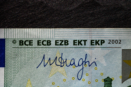 Selective focus on detail of euro banknotes. Close up macro detail of money banknotes, 100 euro isolated. World money concept, inflation and economy concept