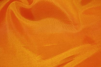 厚手のジャンパーのポリエステルのすべすべした橙色の裏地