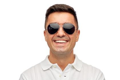face of smiling man in polo t-shirt and sunglasses