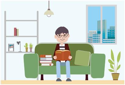 男性が部屋で読書をする