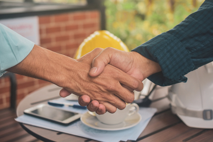Engineering hands shake at work place building construction estate project success,Business people shake hand agreement investment business