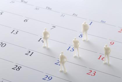カレンダーと人のミニチュア人形