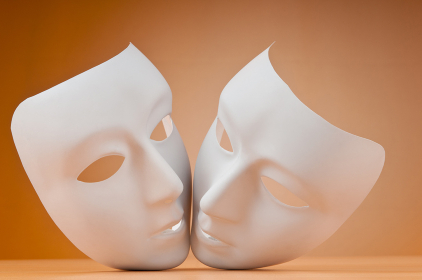 Theatre concept with masks against background