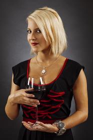 Gorgeous blond drinking red wine