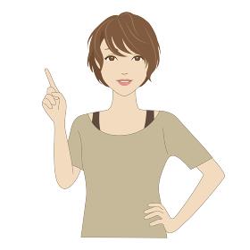 指差しポーズで微笑む女性