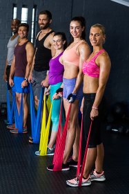 Male and female athletes exercising with resistance band