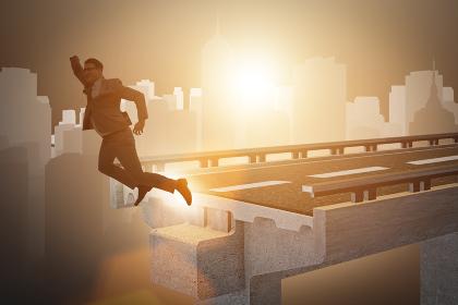 Businessman in uncertainty concept with broken bridge