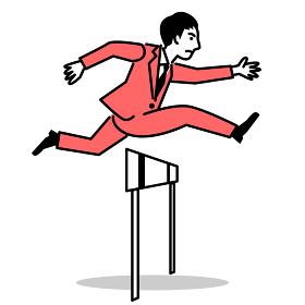 ハードルを飛び越えるビジネスマン