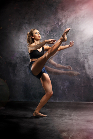 dancer in a pose of modern dance jazz beautiful young dancer in a power pose dressed in street clothes