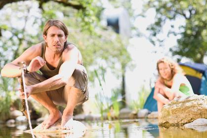 Man and woman at a river
